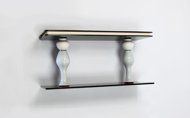 Timeless small sculptural wall-shelve made of